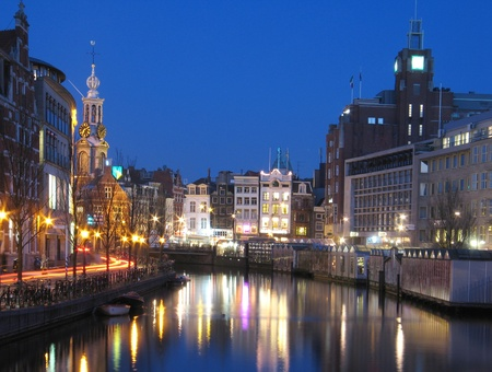 amsterdam canal: Canal and bridge in Amsterdam in the evening