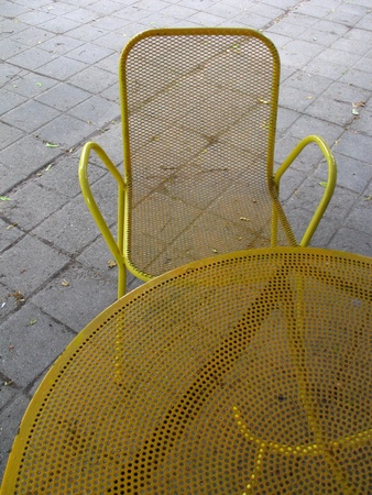 Yellow furniture - empty table and chair photo