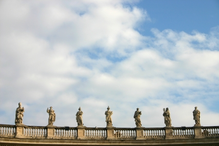 Facade view of Saint Peter church with statues in Vatican, Rome photo