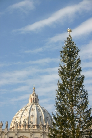 Christmas in Vatican - Saint Peter church with decorated Christmas tree photo