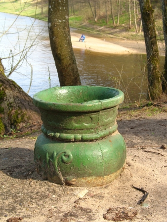 litterbin: Old dustbin in river background in Lithuania Stock Photo