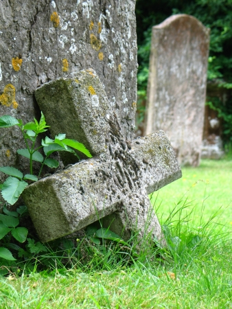 Old grey stone cross in Stratford, England photo
