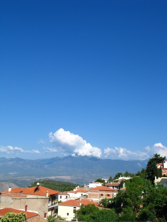 Landscape with small greek city and mountains photo