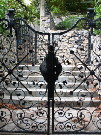 Black ornamented gates in village in Crete photo