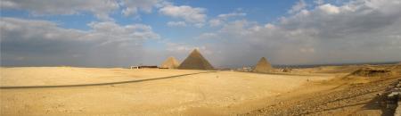 Panorama with three pyramids in Cairo, Egypt photo
