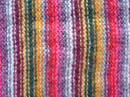 Detail of hand made warm woolen striped shawl photo