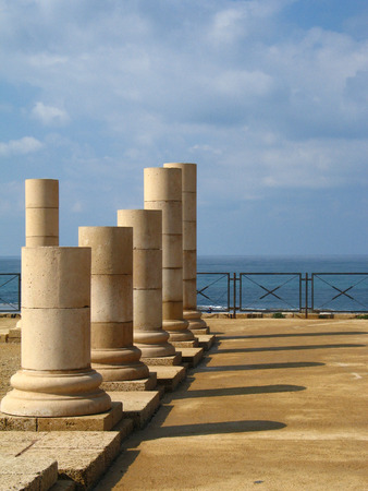 Old columns and the sea in Caesarea, Israel.  photo