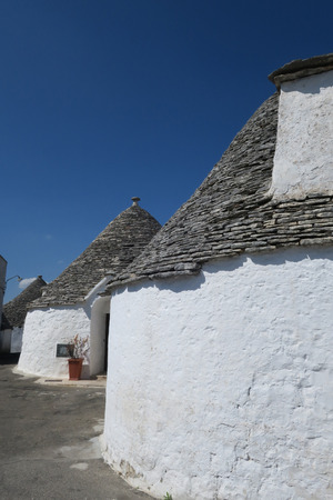 Old traditional white trulli buildings in Alberobello, Italy Stock Photo
