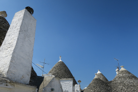Old traditional white trulli buildings in Alberobello, Italy Stock Photo