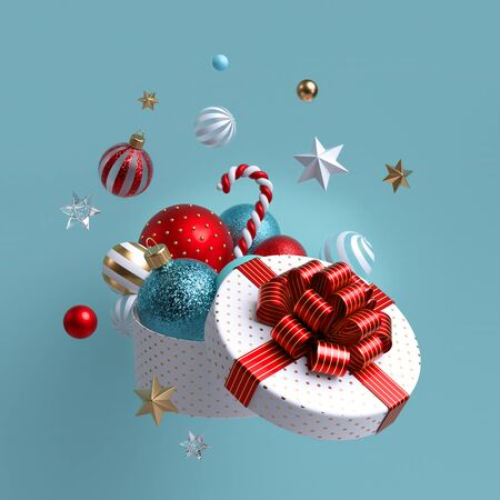 3d Christmas ornaments and glass balls falling out of open round box, white wrapped gift with red bow. Stock Photo