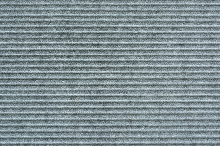 close-up view of grey wavy slate background.slate with horizontal stripes.