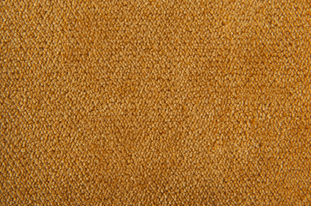 carpeting: fabric texture yellow carpeting for background Stock Photo