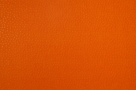 Texture of orange paper for background. Textured with convex balls