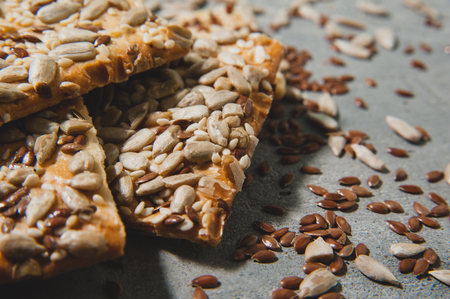 Biscuits with sesame, flax and sunflower seeds. Healthy eating. Stock Photo