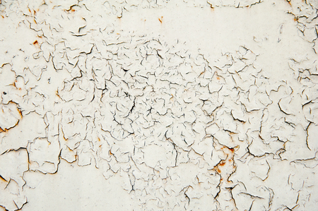 Texture of an old white painted cracked rusty wall Stock Photo
