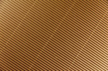 Texture of golden corrugated metallic paper background Stock Photo
