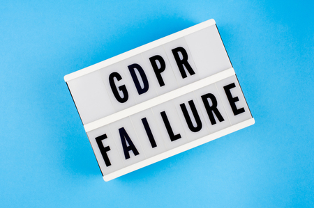 General Data Protection Regulation. Text GDPR failure on a display lightbox on blue background.