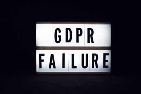 General Data Protection Regulation. Text GDPR failure on a display lightbox in the dark. Stock Photo