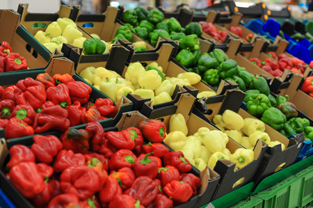 Red, yellow, green bell pepper on the counter in the supermarket