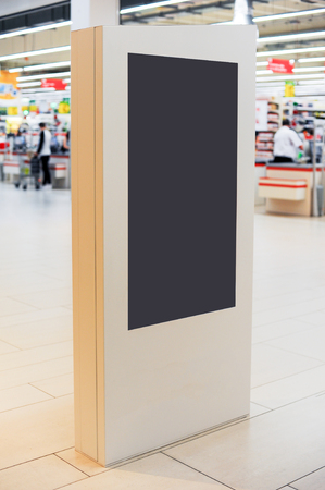 Mockup of digital white screen panel. Blank  modern media billboard in the shopping center. Place for text, advertising or public information. Stock Photo