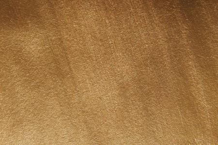 Golden acrylic painted texture. Decorative background. Macro photo. Stock Photo - 115530000