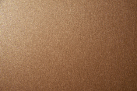 Texture of brown glitter paper background. Macro photo
