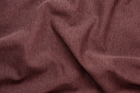 Red wine-colored fabric texture for background
