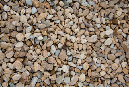 Stone pebbles brown and gray gravel texture background for decoration. Stock Photo - 115530058