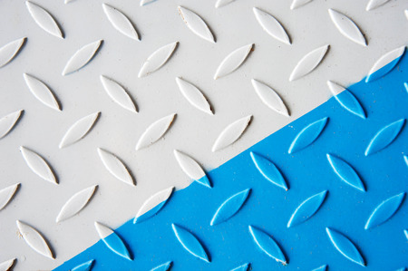 Painted white and blue Metal checkered steel plates background. Industrial texture Stock Photo