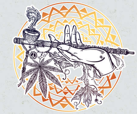 peace pipe: Human hand holding a cannabis smoking pipe of peace.