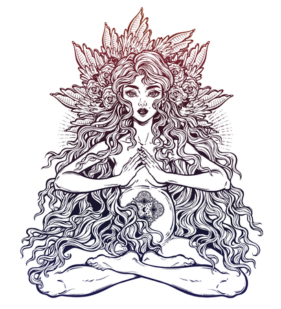 Sacred motherhood. Beautiful boho pregnant woman in lotus position with long hair.