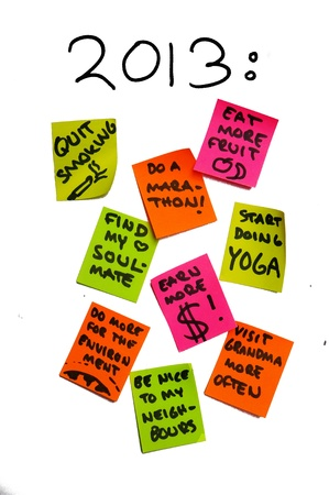 different goals: Post it notes containing new year resolutions for the year of 2013. The many different and ambitious (life) goals give the impression of overambition.