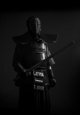 kendo: Standing kendo samurai in armor black white
