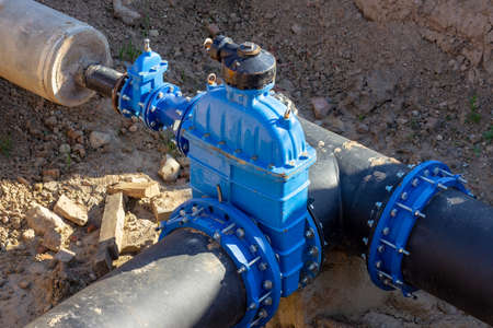 Connection of the construction of main city water blue supply pipeline. Stock Photo