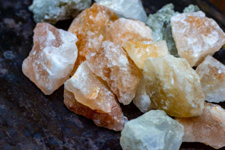 Himalayan lamp white and pink salt crystals for therapy on wooden background.