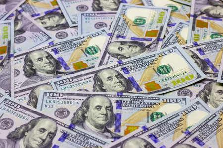 American hundred dollar bills as a money background. Business and finance concept Standard-Bild