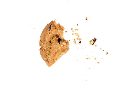 Close up of chocolate chip cookie pieces with crumbs isolated on white background.