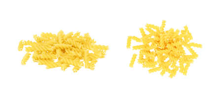 Top view of yellow uncooked fusilli pasta set isolated on white background. Reklamní fotografie