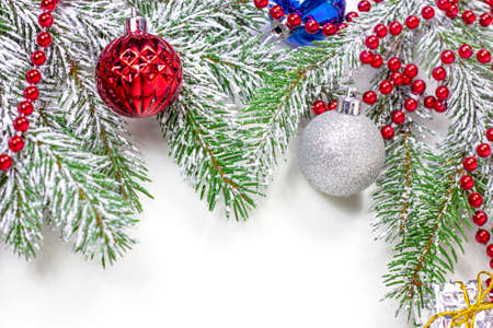 New Year and Christmas decorations with green fir tree branches and Xmas traditional decor with copy space for greeting invitation cards.