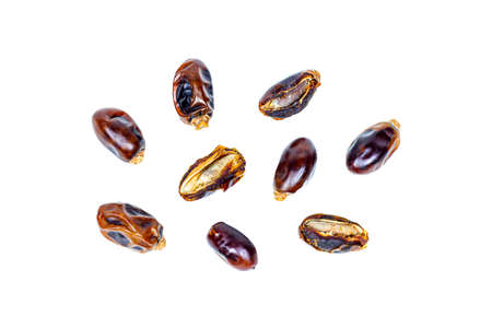 Sweet dried brown dates isolated on white background.