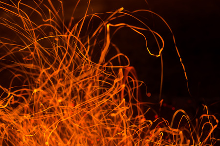 ray trace: long exposure photo of fire sparkles