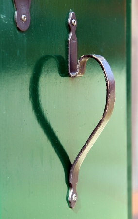 kinship: reflection of the door handle in the shape of heart