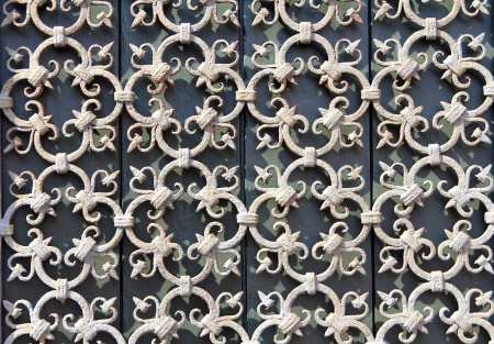 decorative wrought-iron grille on the window photo