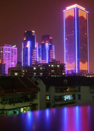 night view of modern buildings of Xiamen, Fujian, China photo