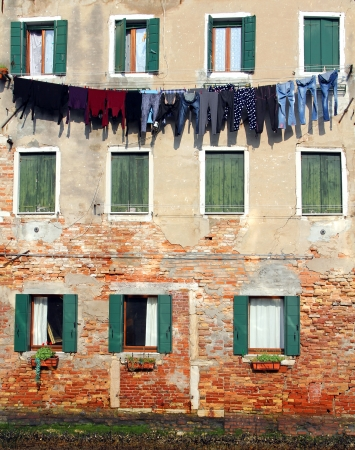 underwear drying on the wall of the house, Venice, Italy photo