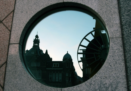 Amsterdam reflected in the round window of the building photo