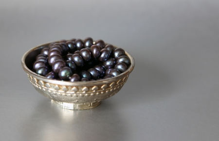silver cup with black pearls photo