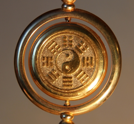 cosmology: gold yin yang sign surrounded by Trigrams