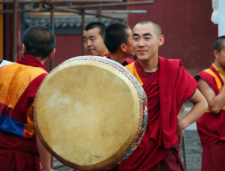 chinese drum: HOHHOT, INNER MONGOLIA - JULE 12  Monks are preparing for the annual holiday presentation at the Dazhao Monastery on Jul 12, 2010  Dazhao is the largest Buddhist monastery of Hohhot, Inner Mongolia, China