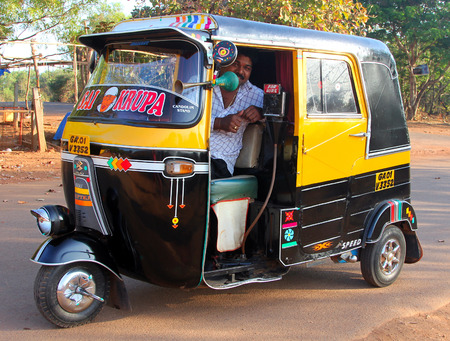 mototaxi: GOA, INDIA - FEB 11, 2014  Indian auto rickshaw  Auto rickshaws  mototaxi or tuk-tuk  are a common means of public transportation in many countries in the world